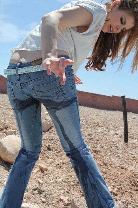 Girl masturbates through pants